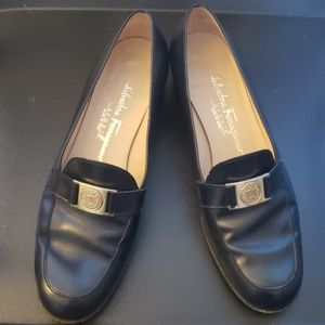 Loafers with strap and logo detailing.